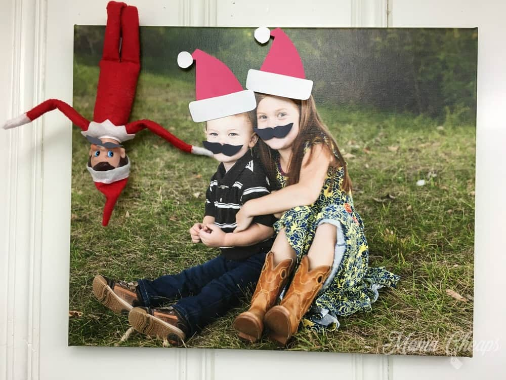 Elf Puts Mustaches on Kids Picture