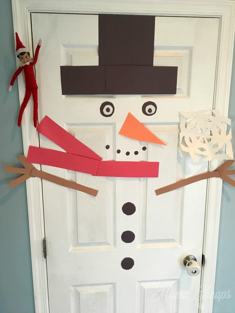 Elf Puts Snowman on Door