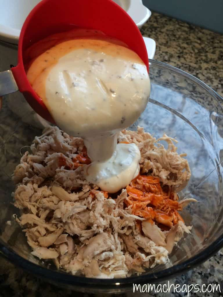 adding kraft creamy ranch dressing to shredded chicken
