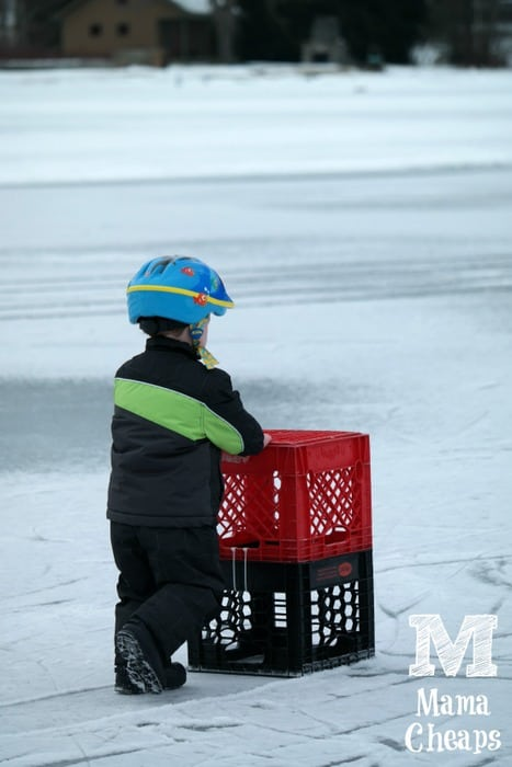 Landon Pushing Crates on Lake Morey