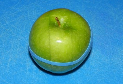 rubber band around apple