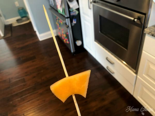 cantaloupe on wooden skewer