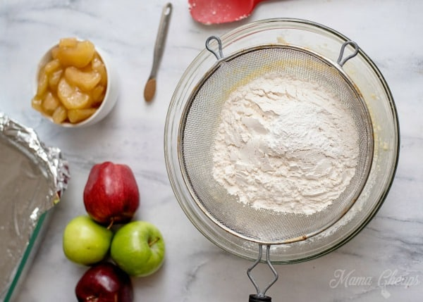 Sifting Flour over pie batter