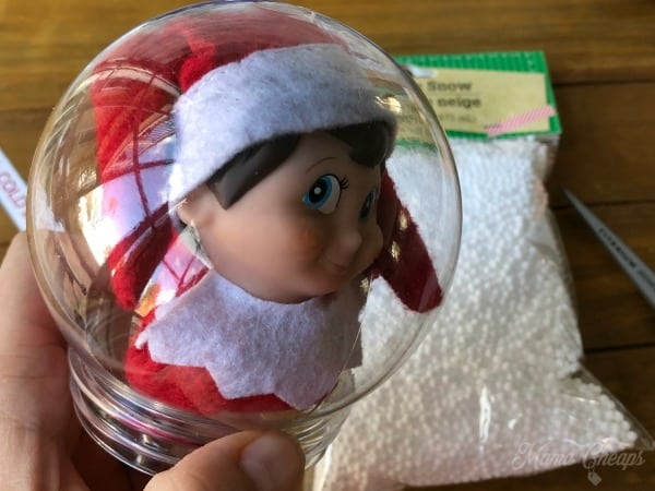 Elf in snow globe