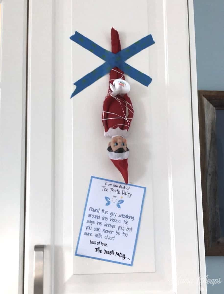 Elf tied up with floss