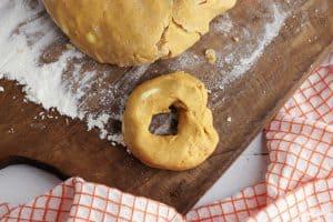 forming pumpkin donuts